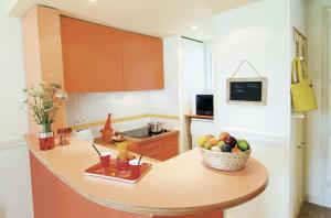 A kitchen or kitchenette at Center Parcs Le Lac d'Ailette