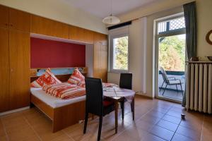 Ein Bett oder Betten in einem Zimmer der Unterkunft Haus Erika