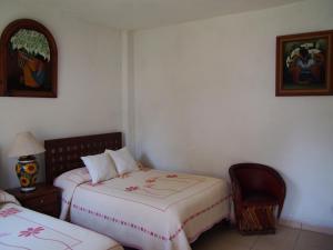 A bed or beds in a room at Balcón de Santo Domingo