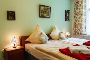 Ein Bett oder Betten in einem Zimmer der Unterkunft Abendquartier Potsdam