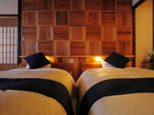 A bed or beds in a room at Hanaougi Bettei Iiyama