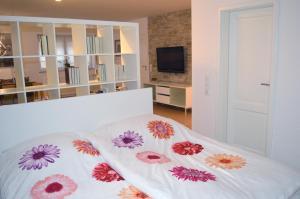 """Ein Bett oder Betten in einem Zimmer der Unterkunft Ferienwohnung """"Ela"""""""