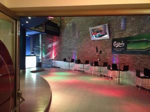 The lounge or bar area at Appartamento Villaggio Olimpico