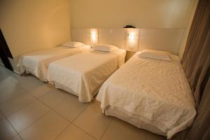 Um quarto em Golden Plaza Hotel