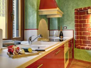 A kitchen or kitchenette at Holiday Home Corte Masato