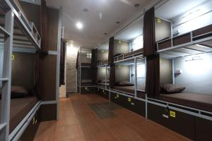 A bunk bed or bunk beds in a room at Dewa Hostel