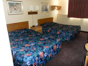 A bed or beds in a room at Super 8 by Wyndham Chadron NE