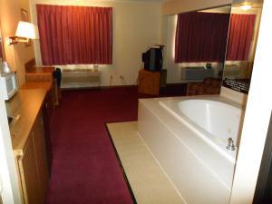 A bathroom at Super 8 by Wyndham Chadron NE