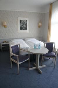 Кровать или кровати в номере Hotel am Steintor