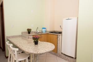 Una cocina o zona de cocina en Pousada Praia Campeche