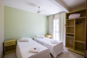 Cama o camas de una habitación en Pousada Praia Campeche