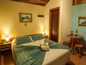 Cama ou camas em um quarto em Pousada Aguia Dourada