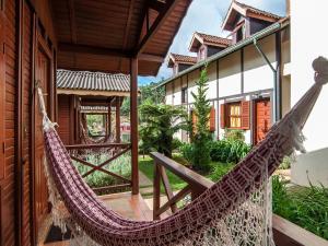 Uma varanda ou terraço em Pousada Aguia Dourada