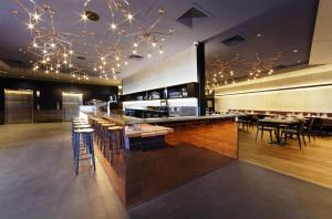 A restaurant or other place to eat at Alpha Mosaic Hotel Fortitude Valley Brisbane