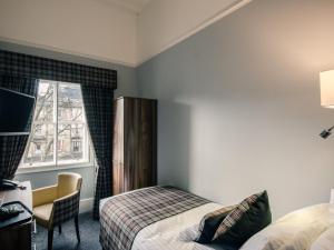 Un ou plusieurs lits dans un hébergement de l'établissement Argyll Western Hotel