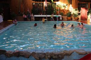 The swimming pool at or near Fort Nelson Hotel