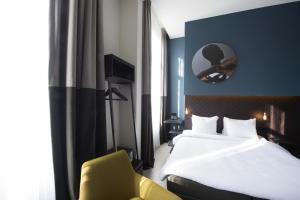 Un ou plusieurs lits dans un hébergement de l'établissement PH Hotel Oosteinde