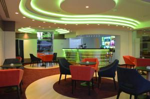 The lounge or bar area at Vassos Nissi Plage Hotel