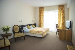 A bed or beds in a room at Meridian Domodedovo