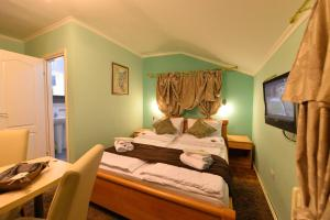 A bed or beds in a room at Guest Accommodation TAL Centar