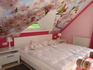Ein Bett oder Betten in einem Zimmer der Unterkunft Haus Dornröschen