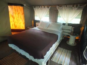 A bed or beds in a room at Kare Lodge