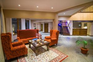 The lobby or reception area at Chalten Suites Hotel