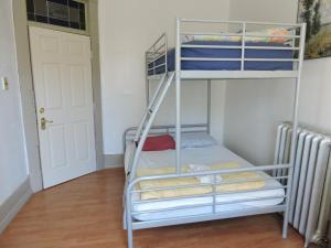 A bunk bed or bunk beds in a room at St. Clair Hotel Hostel