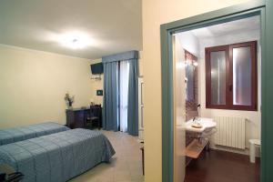 Letto o letti in una camera di Hotel del Rio Srl - RISTORANTE e Azienda agricola
