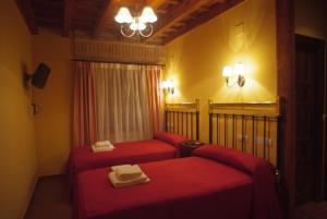 A bed or beds in a room at La Casona de Doña Petra