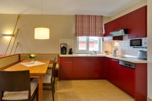 A kitchen or kitchenette at Dorfhotel Boltenhagen