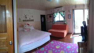 A bed or beds in a room at Linyuan Village