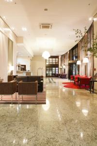 The lobby or reception area at Intercity Porto Alegre