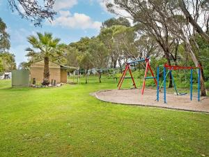 Children's play area at Acclaim Pine Grove Holiday Park