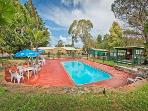 The swimming pool at or near Acclaim Pine Grove Holiday Park