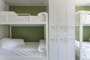 A bunk bed or bunk beds in a room at Youth Hostel Non Stop Inn by IrriSarri Land