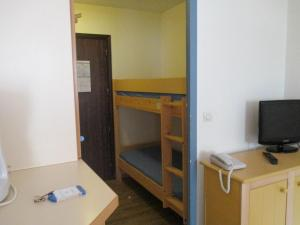 A bunk bed or bunk beds in a room at Promenade des Bains Apartment