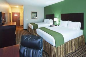 A bed or beds in a room at Holiday Inn Express Hotels & Suites Jacksonville