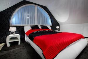 Łóżko lub łóżka w pokoju w obiekcie Hotel Millenium