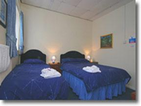 A bed or beds in a room at Portland Lodge