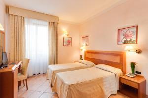 Cama ou camas em um quarto em Hotel Mia Cara