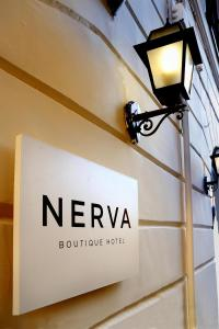 A television and/or entertainment centre at Nerva Boutique Hotel