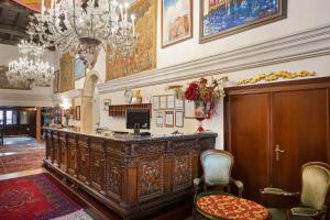 The lobby or reception area at Residenza d'Epoca San Cassiano