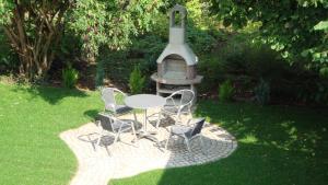 Barbecuefaciliteiten beschikbaar voor gasten van het appartement