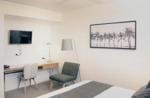 A television and/or entertainment center at Direct Hotels - Pacific Sands