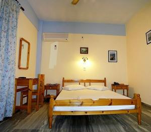 Ένα ή περισσότερα κρεβάτια σε δωμάτιο στο Idroussa