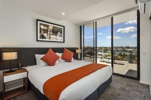 A bed or beds in a room at Quest Woolloongabba