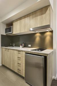 A kitchen or kitchenette at Quest Woolloongabba