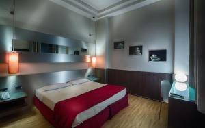 Letto o letti in una camera di Hotel Raganelli