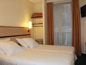 Кровать или кровати в номере Newhotel Saint Lazare